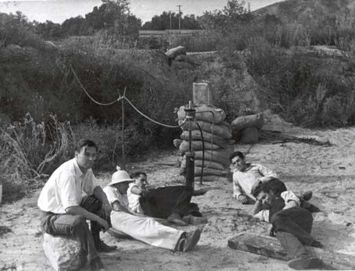 left to right: Rudolph Schott, Apollo Milton Olin Smith, future JPL Director Frank Malina (white shirt, dark pants), Ed Forman and Jack Parsons (right, foreground). Nov. 15, 1936. Image from NASA/JPL-Caltech