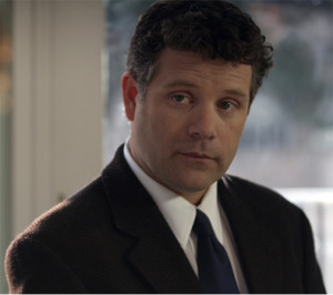 Sean Astin as detective Leon Weed in the film The Freemason