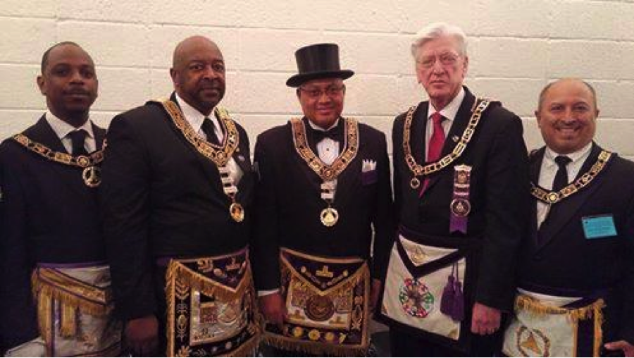 Prince Hall Grand Master Wilbert Curtis is in the middle with the top hat on and to his left (our right) is the Past Grand Master of the Grand Lodge of Texas AF & AM PGM Jerry Martin together at the Prince Hall Grand Session June 25-28, 2015. A historic fraternal exchange.