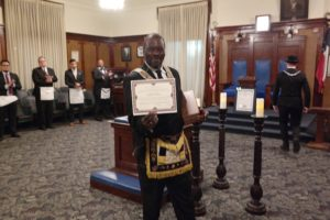 DGM Michael T. Anderson Shows His Certificate Of Honorary Membership In Jewel P. Lightfoot Lodge