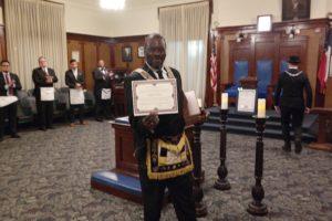 DGM Michael T. Anderson Shows His Certificate Of Honorary Membership In Jewel P. Lightfoot Lodge